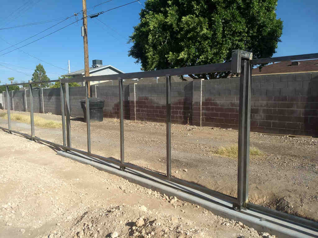 modern steel fence with rolling gate