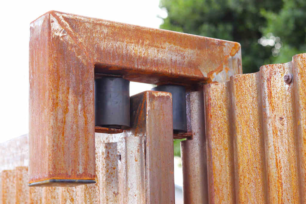rusted steel fence rolling gate guides