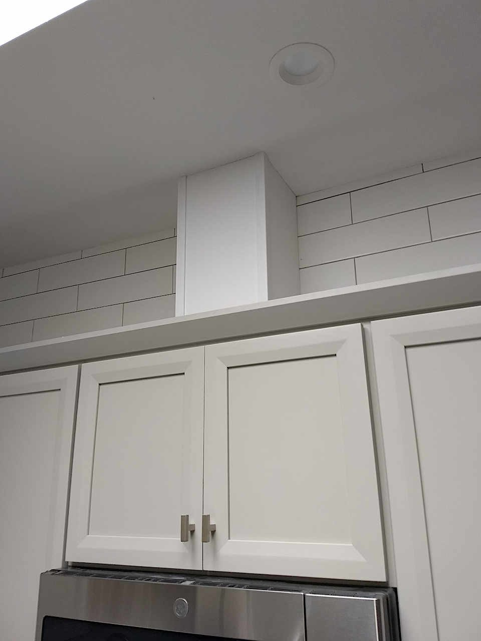 gray-cabinets-vent-box-crown-molding