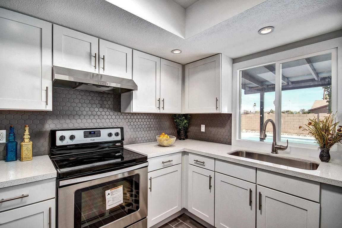 white-shaker-cabinets-gray-hex-backsplash-CC-1
