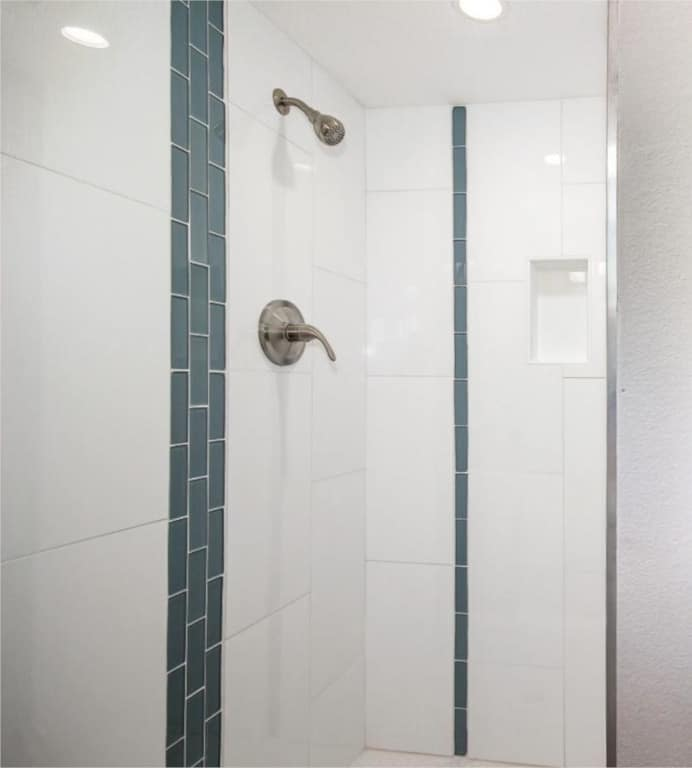 white-shower-tile-blue-accent-CC-2.1