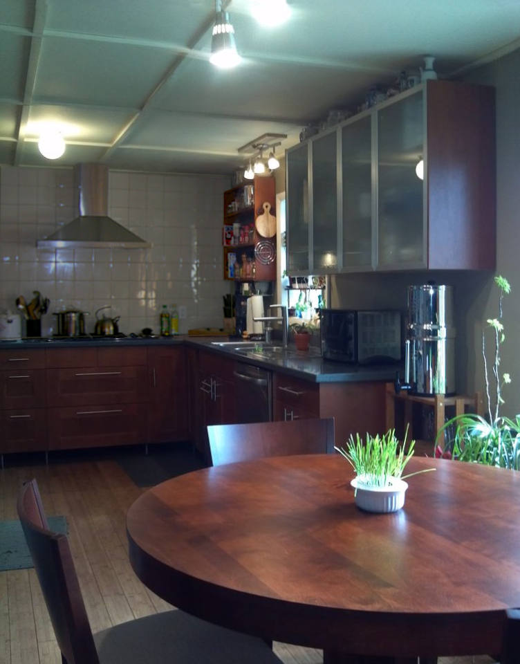 modern kitchen with wood cabinets bamboo floor